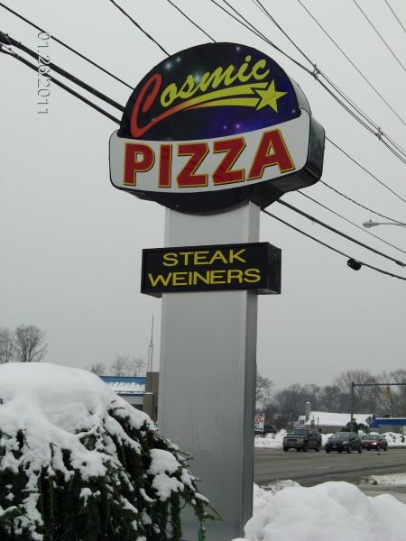 cosmic pizza pylon sign